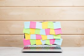 Collection Of Colorful Sticky Memos On A Laptop
