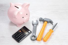 Piggy Bank With Calculator And Tools