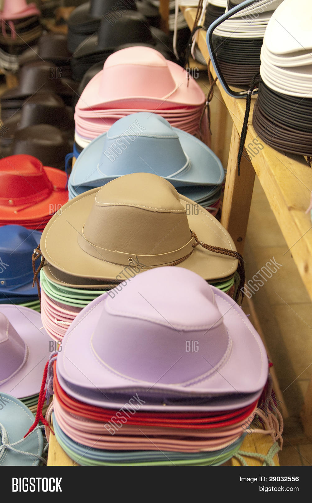a75dfc7e4387b This is some stacks of colorful cowboy hats for kid in a store of the western  festival of St-Tite.