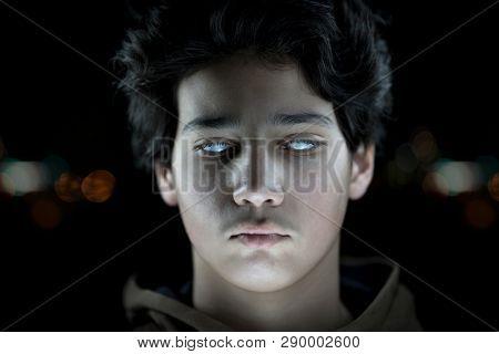 Teenage blind boy with white eyes