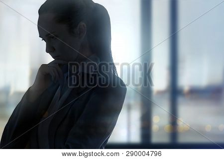 Young Woman Against Of The Window. London Uk