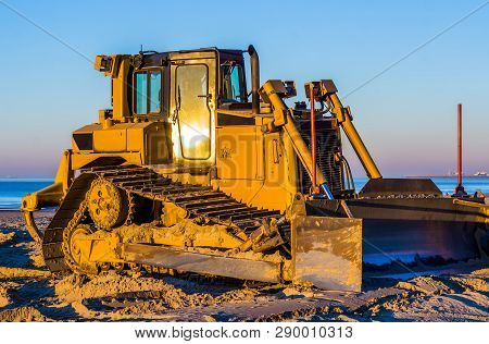 Side View Of A Bulldozer With A Scoop On The Beach, Ground Moving Machine, Groundwork Industry Equip