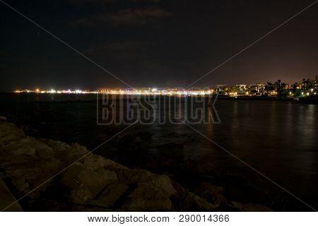 Cyprus, Paphos, Night City Panorama Lights, Coastline And Sea