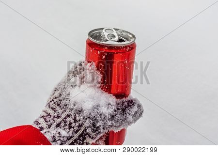 An Opened Red Shiny Bright Tin Can With White Snow On Its Surface With Key For Cool Cold Soft Drinks