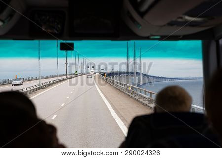 View Of Oresund Bridge From Tourist Bus. Copenhagen Bus Tour. Tourists In Bus Enter Oresund Bridge.