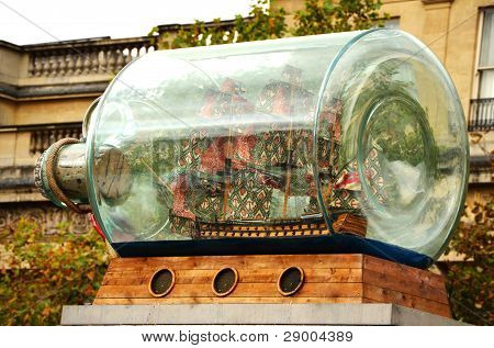 A big bottle with a ship inside is located on the Trafalgar Square.