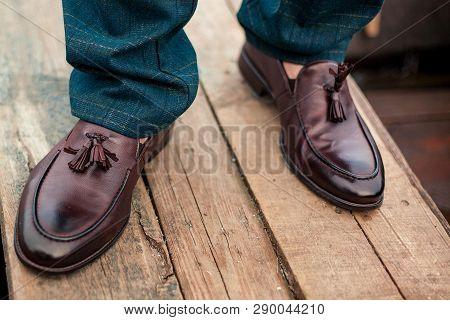 Brown Men's Shoes On The Wooden Floor