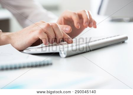 Close-up of hands businessman working in an office.