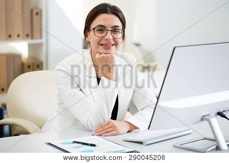 Young beautiful businesswoman with computer in an office