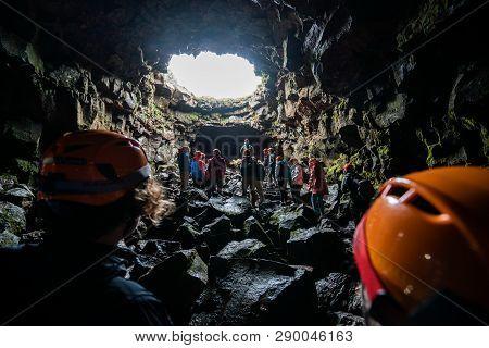 People Explore Raufarholshellir Cave In Iceland.
