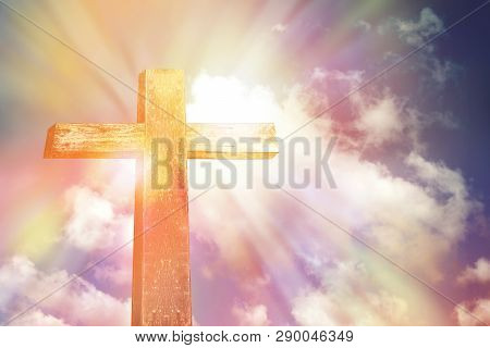 Wooden Cross Shape On Rocky Hill At Sunset With Blue Sky And Clouds Background, Religion Symbol Conc