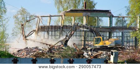 Demolition Of The Old Emergency Building Using Excavator