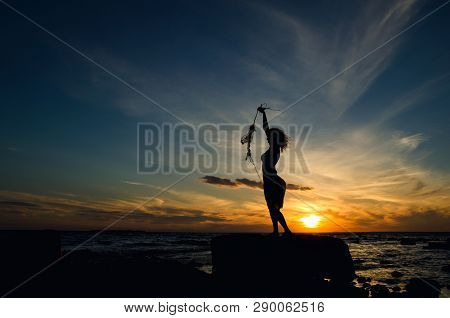 Yoing Woman With Fishing Net At Sunset