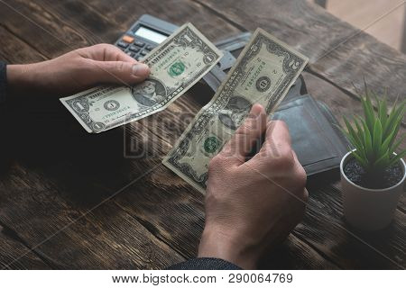 Business Man Is Counting His Last Dollars From An Empty Wallet. Tight Of Money. Lack Of Money. Finan