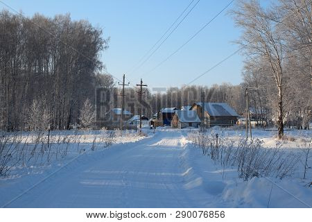 Cleared Wide Road Winter Drive To Private Houses In The Siberian Village Among The Snowdrifts Throug