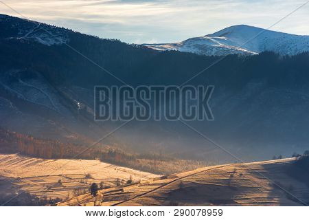 Deep Autumn Scenery In Mountains. Wonderful Scenery With Hills In Morning Light. Trees In Autumn Col