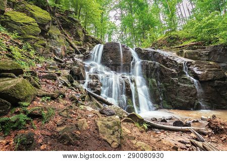 Waterfall On The River Among Forest. Powerful Two Cascaded Water Flow. Spring Freshness In The Beech