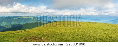 Panorama Of A Mountain Landscape In Summer. Beautiful Scenery With Low Hanging Clouds. Huge Grassy A