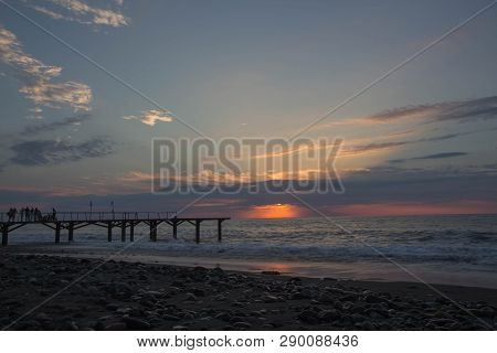 Sun Setting Over Terrace Dock Or Pier. Jetty (pier) Sea And Cloudy Sky Background, Sunset