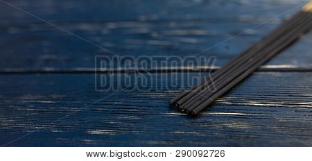 Sandalwood Sticks On A Black Wooden Table. Traditional Asian Culture. Aromatherapy With Free Space F