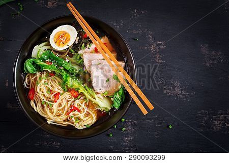 Miso Ramen Asian Noodles With Egg, Pork And Pak Choi Cabbage In Bowl On Dark Background. Japanese Cu