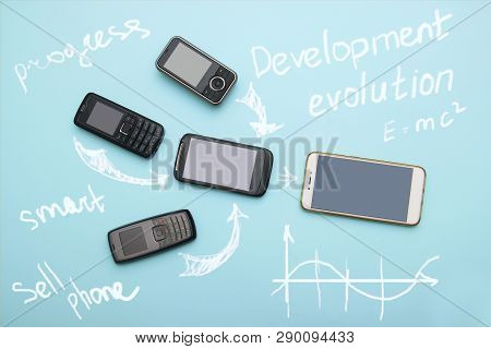 Evolution Of Cell Phones. Technology Development Telephone And Pda Concept. Vintage And New Phones.