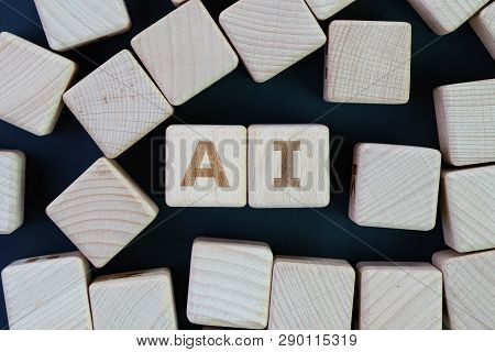 Ai, Artificial Intelligence Or Machine Learning In Future World Concept, Straggle Cube Wooden Blocks