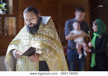 Belarus, Gomel, September 17, 2018. Prudkovsky Church. The Baptism Of The Child.an Orthodox Priest W