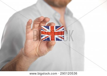 Businessman In Blue Shirt Holding Business Card With European Union Flag