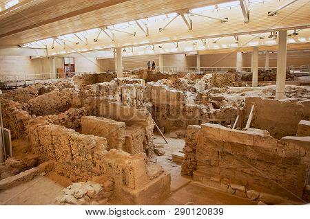 Akrotiri, Greece - August 01, 2012: Unidentified Tourists Visit Akrotiri Archaeological Site In Akro