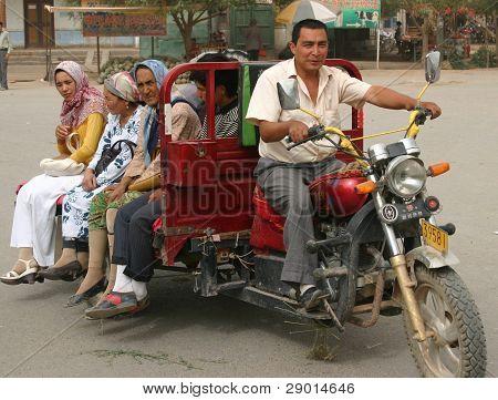 A Uyghur man driving a public taxi in Kashgar, China