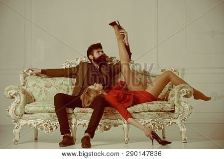 Intimate Moment Of Sexy Couple. Intimate Caresses Of Bearded Man And Elegant Businesswoman. Intimate