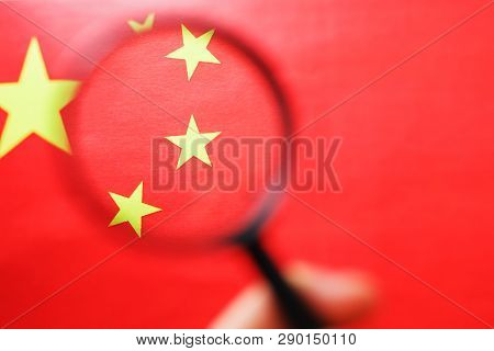 The Peoples Republic Of China A Flag Is Watched Through Magnifying Glass. Spies And Observation Of P