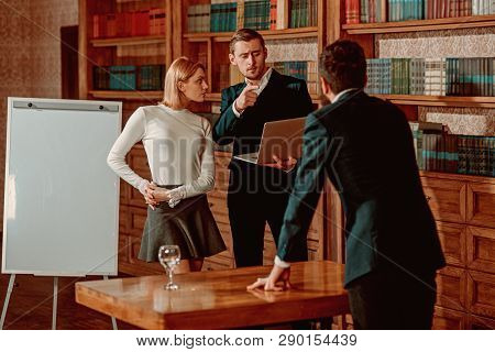 Brainstorming Concept. University Students Hold Brainstorming Session In Library. Business Men And W