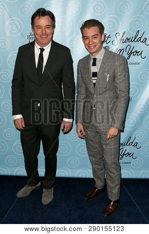NEW YORK-APR 14: Film producer Tony Marion (R) and guest attend the Broadway opening night for 'It Shoulda Been You' at Brooks Atkinson Theatre on April 14, 2015 in New York City.