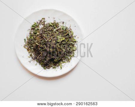 Pile Of Dried Oregano Leaves And Flowers For Herbal Tea. Dried Origanum Vulgare, Pot Marjoram On Whi