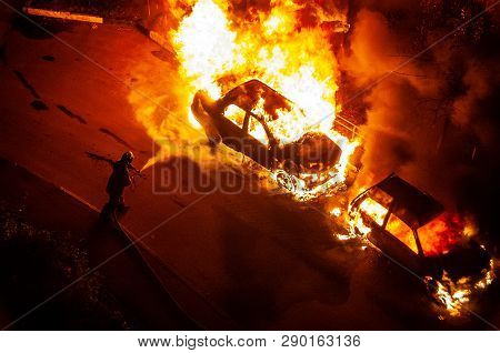 Burning Car Is A Flame. Firefighters Extinguish The Fire. Set Fire To Cars