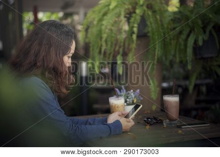 Study And Technology Concept.person Side View Of Sad Woman Using Mobile Phone At Coffee Shop.asian W