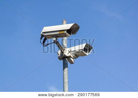 Security Camera . Modern Cctv Camera On A Wall. Concept Of Surveillance And Monitoring.