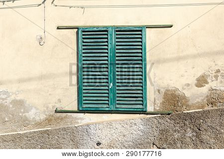 Green Window On Old Traditional House In Italy
