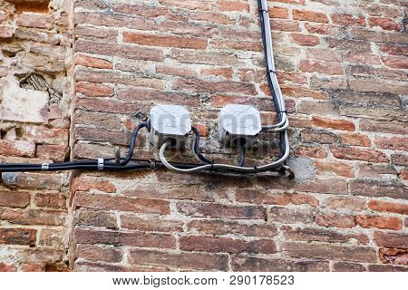 Cable Electrical On Outdoor Wall .lectrical Boxes And Lots Of Electrical Wires Connecting