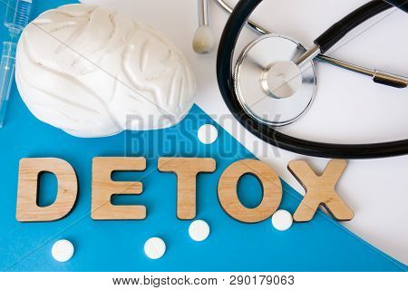 Brain Detox Concept Photo. Word Detox Of Volumetric Letters Is Near 3d Brain Model And Medical Steth