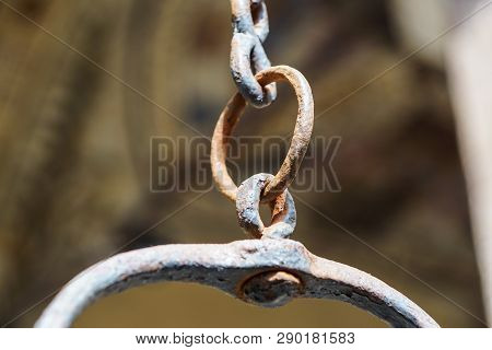 Metal Chain Rings Brown Old Weathered Hanging Piece Of Chain Length On A Sunny Green Blurred Backgro