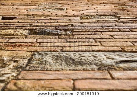 An Stone Wall Of A Building From The Ground Prespective Looking Up. Brick Wall