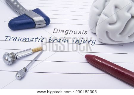 Figure of human brain, blue neurological reflex hammer, neurological needle and brush for test sensitivity and ballpoint pen lie on a paper form with a medical diagnosis of Traumatic brain injury poster
