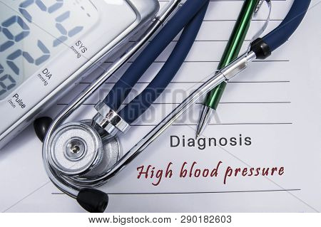 Diagnosis High Blood Pressure. Stethoscope And Electronic Sphygmomanometer Lie On Medical Paper Form