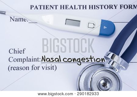 Chief Complaint Nasal Congestion. Paper Patient Health History Form, On Which Is Written The Complai