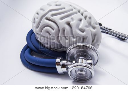 The Figure On The Brain Is On Twisted Into A Spiral Tube Of The Stethoscope With Chestpiece, Which A