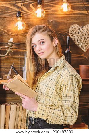 Poetry Evening Concept. Girl In Casual Outfit In Wooden Vintage Interior Enjoy Poetry. Girl Reading