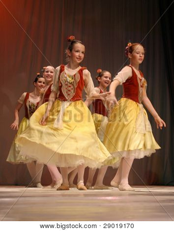 Group of young girls dancing on stage